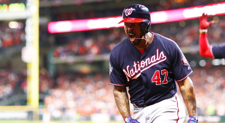 Howie Kendrick #47 of the Washington Nationals celebrates his two-run home run against the Houston Astros during the seventh inning in Game Seven of the 2019 World Series.