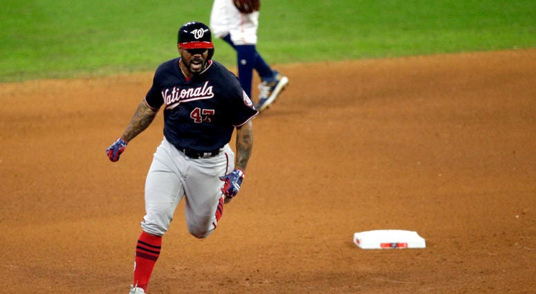 Howie Kendrick #47 of the Washington Nationals hits a two-run home run against the Houston Astros during the seventh inning in Game Seven of the 2019 World Series.