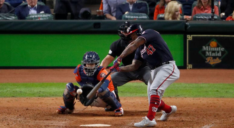 Howie Kendrick #47 of the Washington Nationals hits a two-run home run against the Houston Astros during the seventh inning in Game Seven of the 2019 World Series