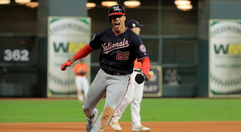 Juan Soto #22 of the Washington Nationals celebrates as he comes home to score a run on a home run by Howie Kendrick (not pictured) against the Houston Astros during the seventh inning in Game Seven of the 2019 World Series.