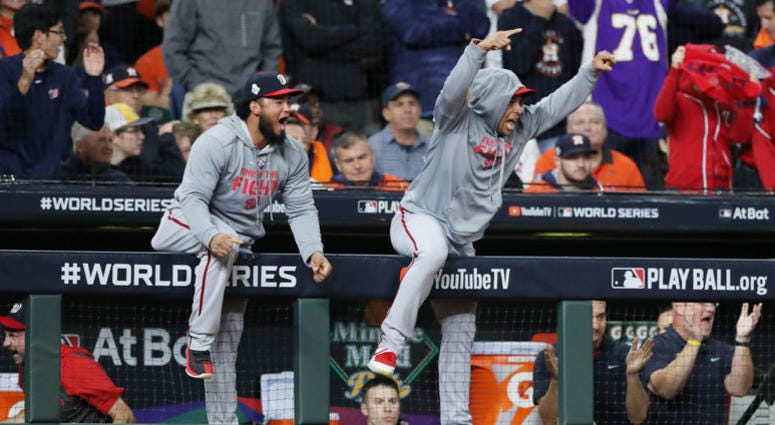 The Washington Nationals celebrate a two-run home run by Howie Kendrick (not pictured) against the Houston Astros during the seventh inning in Game Seven of the 2019 World Series.
