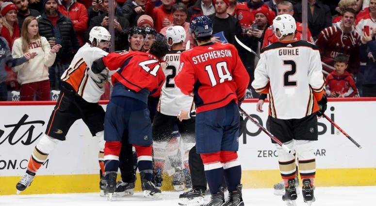 Erik Gudbranson of the Anaheim Ducks punches Garnet Hathaway of the Washington Capitals