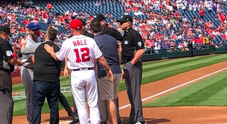 Grant Paulsen and Danny Rouhier exchange lineup cards at Nats Park.