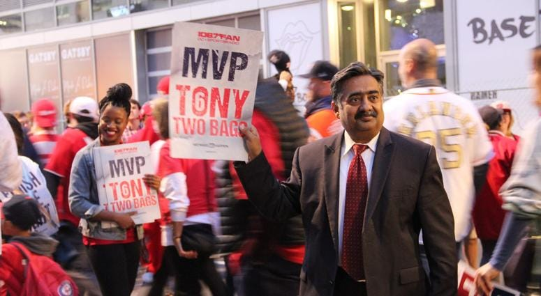 """A fan holds a """"Finish The Fight"""" card outside Nationals Park before Game 4 of the World Series."""