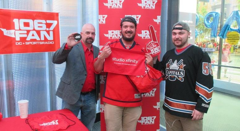 Fan stop by Studio Xfinity before the Hockey Finals