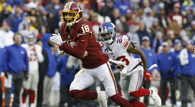 Redskins WR Josh Doctson runs with the ball against the Giants.
