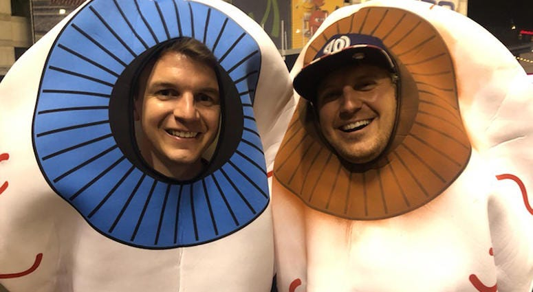 Fans dress as baby sharks at Game 5 of the World Series at Nationals Park.