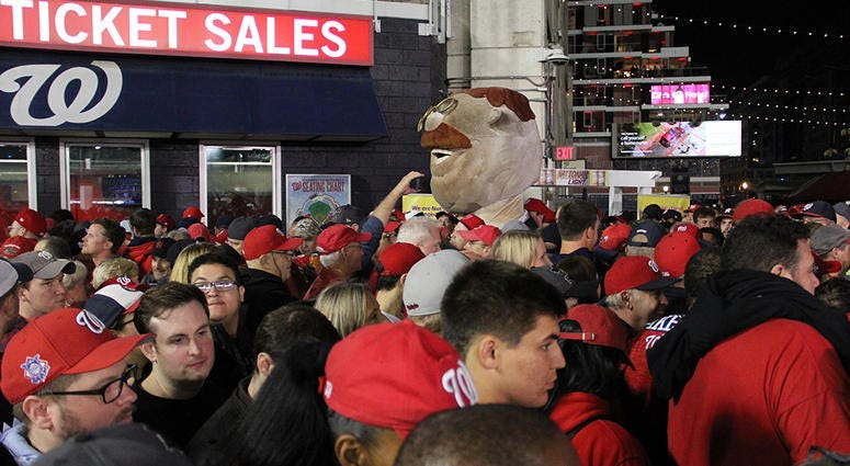 Teddy, one of the Racing President's at Nationals Park, walks the crowded concourse at Nationals Park during Game 4 of the World Series.