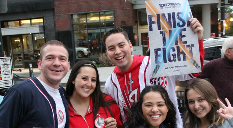"""""""Finish The Fight"""" cards were handed out before Game 4 at Nationals Park on Saturday, October 26."""