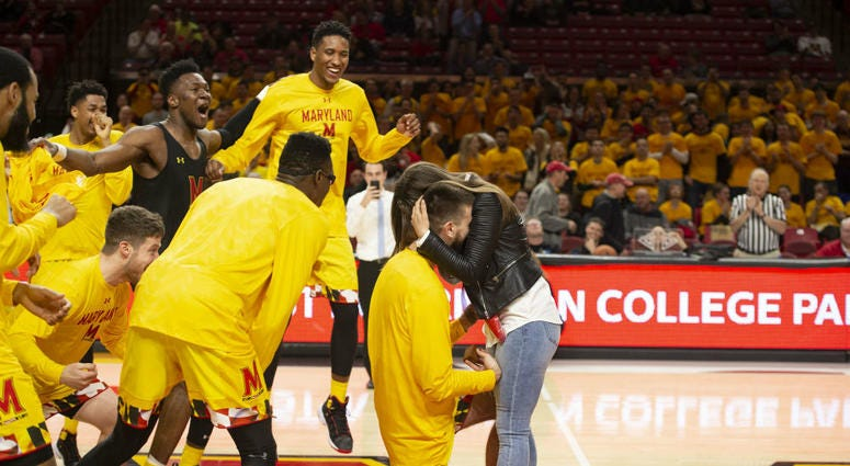 Maryland Terps senior Ivan Bender proposes to his girlfriend Andrea Knezevic at Senior Night.