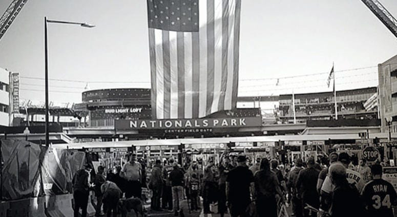 A large flag hangs over the entrance of Nationals Park for Game 5 of the World Series on Sunday, October 27.