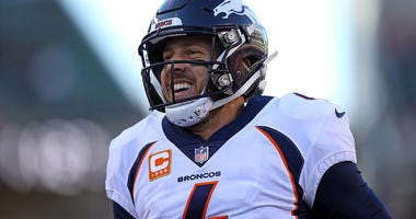 Case Keenum is all smiles after throwing a touchdown last December.