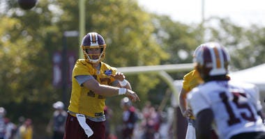 Redskins QB Colt McCoy throws a pass at training camp.
