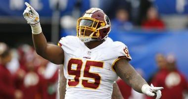 Redskins defensive lineman Daron Payne celebrates a sack.