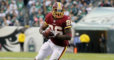 Clinton Portis of the Washington Redskins runs the ball against the Philadelphia Eagles in 2010.