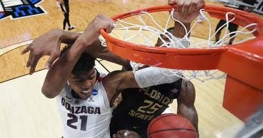 Rui Hachimura of the Gonzaga Bulldogs dunks the ball against Mfiondu Kabengele of the Florida State Seminoles during the 2019 NCAA Men's Basketball Tournament