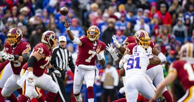 Dwayne Haskins throws a pass against the Buffalo Bills during a Redskins loss.