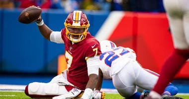 Dwayne Haskins #7 of the Washington Redskins holds the ball up after being sacked on a third down by Tre'Davious White #27 of the Buffalo Bills during the fourth quarter at New Era Field on November 3, 2019 in Orchard Park, New York.