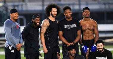 Colin Kaepernick stands with Bruce Ellington, Brice Butler, Jordan Veasy, and Ari Werts at his NFL workout.