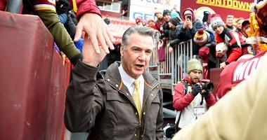Redskins president Bruce Allen walks on the field prior to the game against the Jets at FedExField.