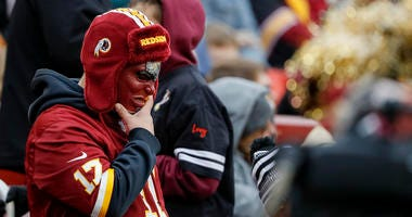 A sad Redskins fan reacts to a bad play during the team's loss to the Jets.