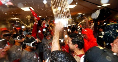 Washington Nationals celebrate in the locker room after defeating the Houston Astros in Game Seven to win the 2019 World Series.