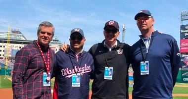 The Sports Junkies on the field at Nationals Park.