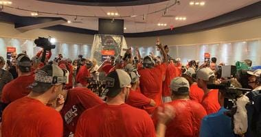 The Nationals celebrate in the clubhouse after clinching a playoff spot.