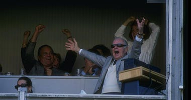Washington Redskins owner Jack Kent Cooke celebrates during a game against the Dallas Cowboys at RFK Stadium in Washington, D. C. The Redskins won the game, 19-15.