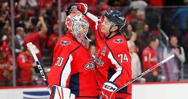 John Carlson celebrates a win with rookie goaltender Ilya Samsonov