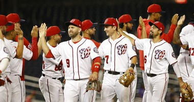 The Nationals celebrate a win over the Rockies Wednesday night.