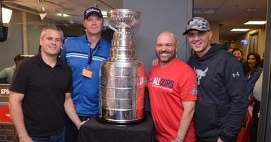 The Sports Junkies pose with The Stanley Cup