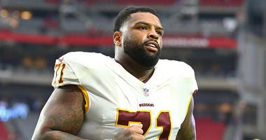 Redskins president laughs off Trent Williams report: 'We expect him'