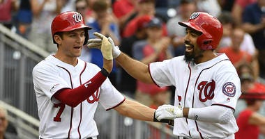 Washington Nationals third baseman Anthony Rendon is congratulated by shortstop Trea Turner.