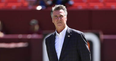 Washington Redskins president Bruce Allen looks over the field before a game against the Cowboys.