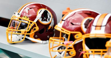 Washington Redskins helmets are seen on the bench against the Miami Dolphins.