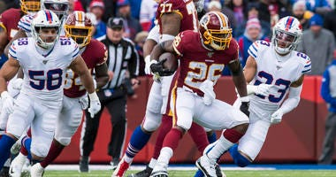 Redskins running back Adrian Peterson runs against the Buffalo Bills.