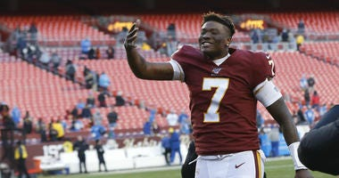 Dwayne Haskins celebrates while leaving the field after the Redskins beat the Detroit Lions.