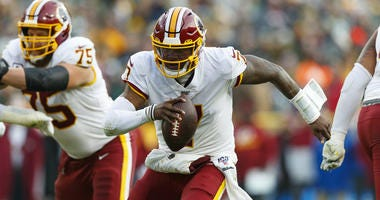 Washington Redskins quarterback Dwayne Haskins rushes with the football during the fourth quarter.