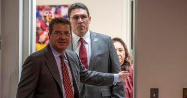 Washington Redskins head coach Ron Rivera follows owner Daniel Snyder into his introductory press conference.