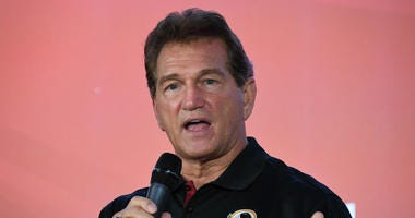 Washington Redskins former quarterback Joe Theismann speaks during the NFL International Series Fan Rally.