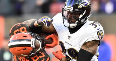 Ravens CB Brandon Carr makes a tackle in Cleveland.