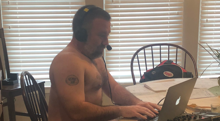 Jeremy wears his Sunday best while broadcasting from his dinning room