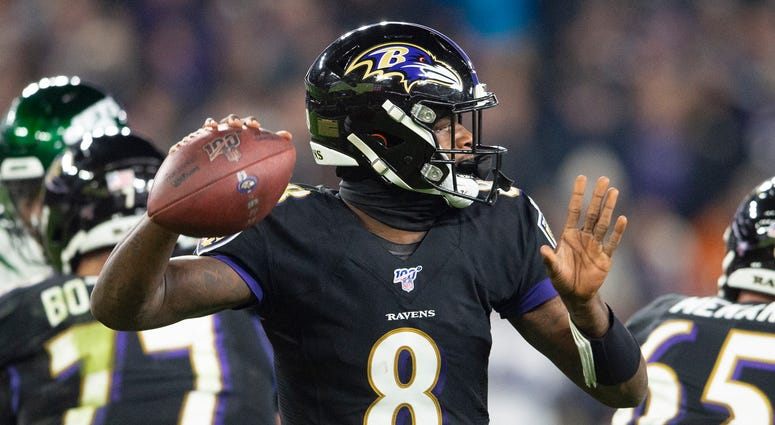 Lamar Jackson throws a TD pass in the third quarter in a 42-21 win over the Jets.