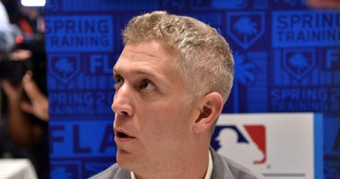 Mike Elias responds to reporters questions at media day