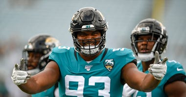 Calais Campbell poses for a photo before a Jaguars game