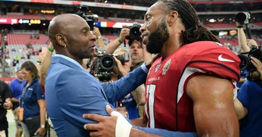 Jerry Rice and Larry Fitzgerald catch up after a game
