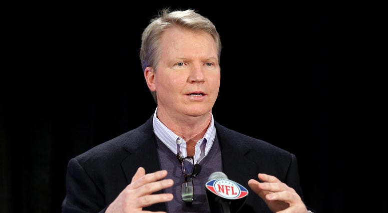 Phil Simms speaks at the Fed Ex Air and Ground Player of the year award press conference