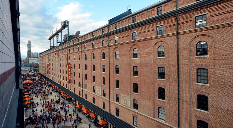 Fans walk down Eutaw Street at Oriole Park