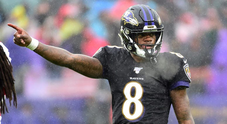 Lamar Jackson reacts after picking up a first down vs San Francisco.